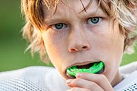 Boy-putting-in-his-mouth-guard